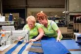 Bedrijfskleding repareren