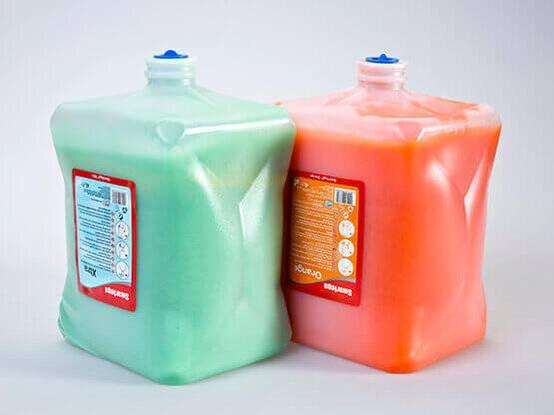Zeepdispenser industriezeep vullingen oranje en groene zeep